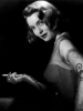 Patricia_Neal_posing_with_cigarette_.jpg